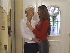 Blonde and brunette lesbos licks each other's tittys