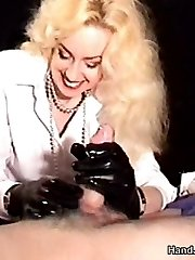 Handjob with black latex gloves on