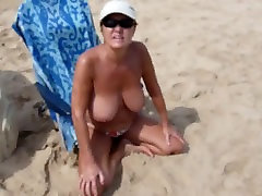 Spanish Woman with big tits on Nudist Beach!