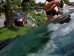 Girl in swimsuit at the car wash