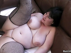 Busty lady in fishnets swallows big black cock