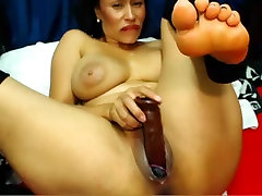 Sexy latina dildoing her creamy pussy
