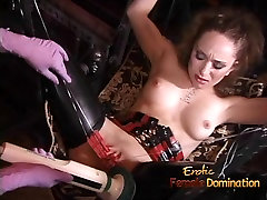 Two latex-clad harlots spank a ginger bitch before having so