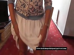 Homely British housewife lifts her skirt and shows tight red cotton panties