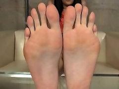 Tickling Asian feet
