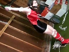 Slutty girl in strict strappado bondage