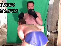 Gay boxing in shiny blue satin shorts