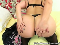 Curvy milf Louise Bassett is fingering her mature pussy