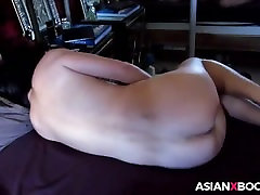 Asian MILF masturbates to orgasm