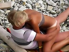 Teen girl with sexy tan lines fucks her boyfriend on a beach