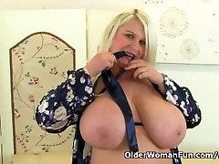 Big titted milf Sam fucks herself with a dildo