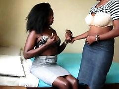 Lustful ebony lesbian babes close up dildo doggy fucking