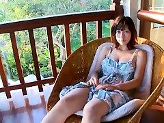 Bosomy Asian chick Kirika Nishino likes her big boobs a lot