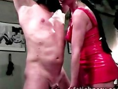Big boobed brunette mistress in latex punishes hung sex slave