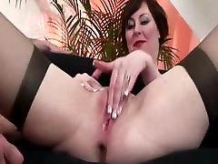 Mature lady in stockings fucks and sucks