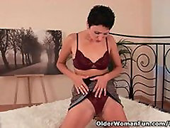 Classy mature mom with hard nipples fucks herself with a dildo