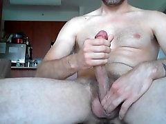 Massive cock covered in cum