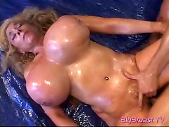 Oiled mature with giant juggs
