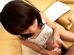 Pretty Asian babe sends her gifted hands taking a fat dick