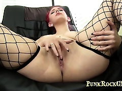Hot redhead girl fucks her pussy