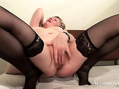 Mature in stockings giving herself and orgasm