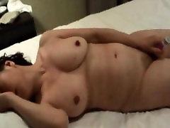 Horny Asian MILF masturbating and blowing