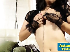 Ladyboy in lingerie tugs her cock in solo fun