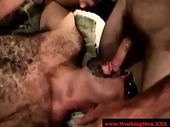 Hairy mature bear feeding on cock
