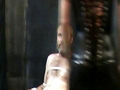 Redhead mistress milking a tied slave