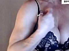 mature muscle girl flexing arms