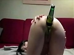 Asian girl plays with a bottle www.Arab-videosx.com Anal
