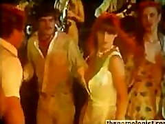 Girl jacks off dude in disco and gets fucked in retro porn movie