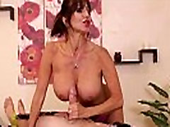 Femdom masseuse strokes clients cock