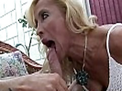 Mature blonde with a great rack fucked by a horny young stud