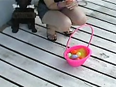 Kitty flashing her panties hunting for Easter eggs