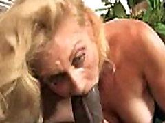 Horny MILF fucks young black stud 12