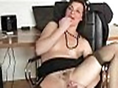 Gorgeous brunette in sexy black stockings masturbates in solo