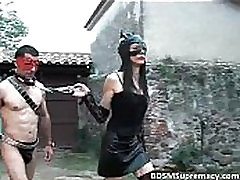 Outdoor BDSM play where leather mistress