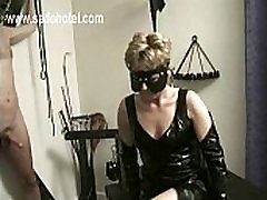 Slave wearing latex dress and mask mastrubates cock of tied slave and get spanked on her butt bdsm