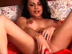 Big busted Ladyboy gets workout with huge red vibrator.