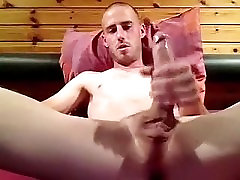 Fascinating male is jerking within doors and memorializing himself on camera