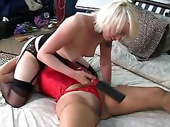 Serf worships mistresses bawdy cleft and goddess spanks slaves wet crack with a paddle