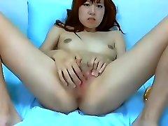 Asian webcam whore rubs her moist pussy