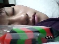 Xio spreads her legs and masturbates in asian voyeur video