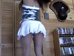 Sexy brunette teasing and dancing in satin panties