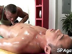 Metrosexual dude receives his cock sucked by gay masseur