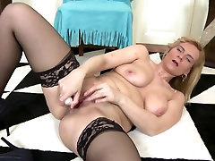 Lovely mature mommy in black stockings
