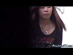 Asians filmed gushing pee
