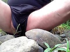 wank on the rocks in black adidas shiny shorts