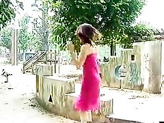 Shy Japanese girl slowly gets naked in public